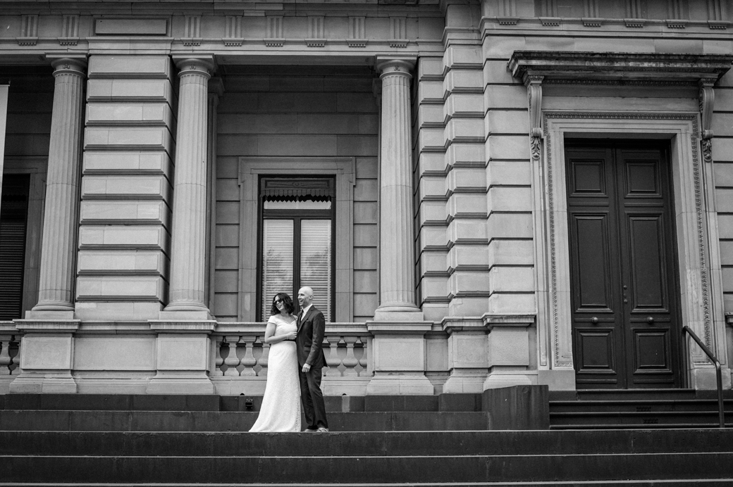 wedding photo on the steps of Treasury Building in Melbourne